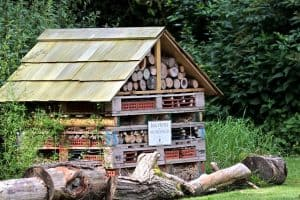 a bug hotel, insect hotel in a garden