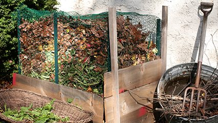 compost bin with wire mesh around it
